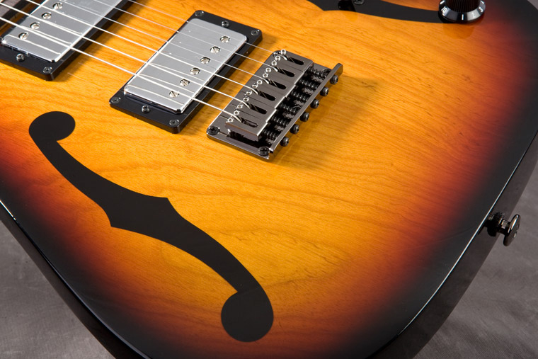 Paul Gilbert's new Signature PGM401TFB has an ashbody with a dramatic Trifade Burst finish.